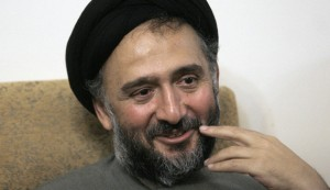 Former Iranian Vice President Mohammad Ali Abtahi smiles as he sits at his home in Tehran, after he was released from jail