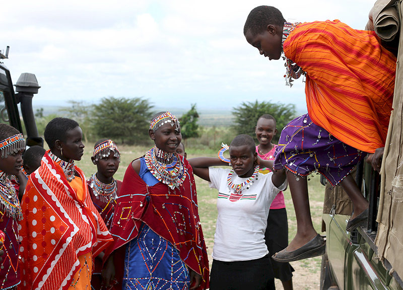 Maasai girls arrive for the start of a social event advocating against harmful practices such as Female Genital Mutilation (FGM) at the Imbirikani Girls High School in Imbirikani, Kenya, on April 21, 2016. Photo courtesy of Reuters/Siegfried Modola